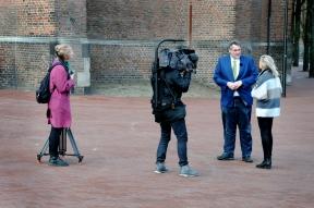 Cameraman met uitrusting.